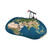 Pumpjack sucking the earth Stock Image