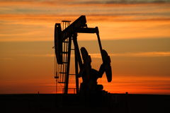 Pumpjack at sunset. Royalty Free Stock Photography