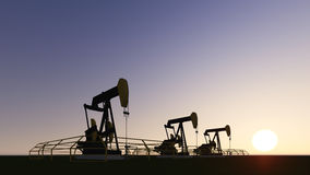 Pumpjack and sunset Stock Photography