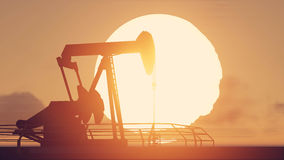 Pumpjack and sunset. In twilight time Royalty Free Stock Photos