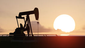 Pumpjack and sunset Stock Image