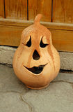 Pumpkin. One smiling pottery pumpkin on the ground. pumpkin is on the ground royalty free stock image