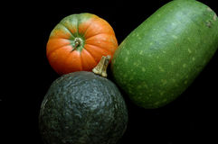 Pumpkin. Three autumn pumpkin in the dark background Stock Images