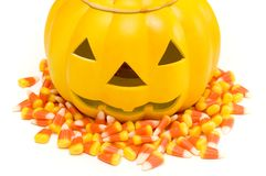 Pumpkin. Halloween pumpkin with candy corn on white royalty free stock photo