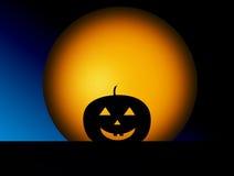 Pumpkin. Orange sphere and black pumpkin over blue background Royalty Free Stock Photo