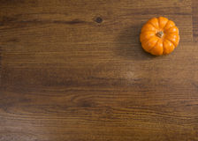 Pumpkin Against Wood Background Royalty Free Stock Photos