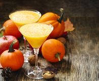 Pumpkin alcohol cocktail for fall and halloween parties. Copy space Royalty Free Stock Photography