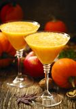 Pumpkin alcohol cocktail for fall and Halloween parties. Pumpkin alcohol cocktail in glasses for fall and Halloween parties Royalty Free Stock Photos