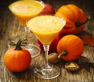 Pumpkin alcohol cocktail for fall and halloween parties. Glasses of Pumpkin alcohol cocktail for fall and halloween parties Stock Images