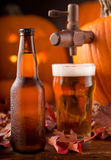 Pumpkin Ale. A bottle and glass of cold creamy pumpkin ale Royalty Free Stock Photo