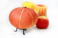 Pumpkin, apple, candle Stock Photo