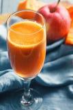 Pumpkin and apple juice closeup Stock Photography