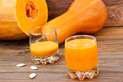 Pumpkin and apple juice Stock Images