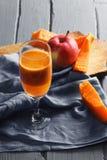 Pumpkin and apple juice Stock Image