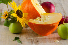 Pumpkin and apples royalty free stock photography