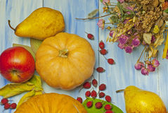 Pumpkin, apples and pears on a blue wooden background Stock Photos