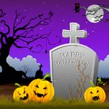 Pumpkin around Tomb Stone Royalty Free Stock Image