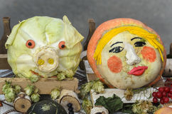 Pumpkin as a person and cabbage in the form of the head of the p Stock Photography
