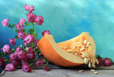Pumpkin with autumn flowers Royalty Free Stock Image