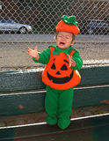 Pumpkin Baby Cry. Cute baby boy dressed in a pumpkin costume Stock Photo
