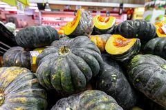 Pumpkin background. Many pumpkins on a local organic food market on Bali island, Indonesia. Asia royalty free stock photography