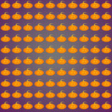 A Pumpkin background on purple background. A background of pumpkins for Halloween Stock Photos