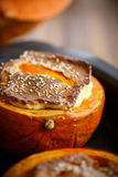 Pumpkin baked with cheese and sesame seeds. On a baking sheet stock photos