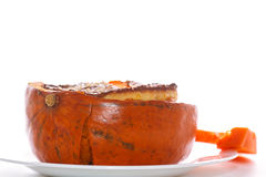 Pumpkin baked with cheese and sesame seeds. On a baking sheet stock photo