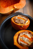 Pumpkin baked with cheese and sesame seeds. On a baking sheet royalty free stock photography
