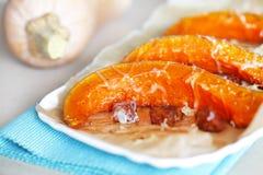 Pumpkin baked with chorizo sausage and cheese Stock Photos