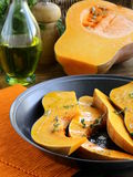 Pumpkin baked with herbs and spices Royalty Free Stock Image