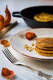 Pumpkin baked pancakes on a plate Royalty Free Stock Image
