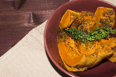 Pumpkin baked with spices and decorated with thyme toned selective focus Stock Images