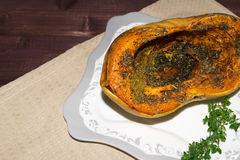 Pumpkin baked with spices and decorated with thyme toned selective focus Royalty Free Stock Photography