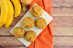 Pumpkin banana muffins. Homemade baked pumpkin banana muffins Royalty Free Stock Photo