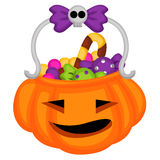 Pumpkin basket with candies Stock Photo