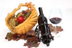 Pumpkin basket full of fruit  and red wine Royalty Free Stock Photos