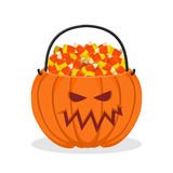 Pumpkin basket for Halloween. Trick or treat. Corn candy for ter Stock Images