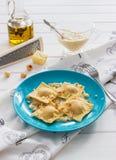 Ravioli blue plate cotton tablecloth hazelnut cheese. Pumpkin blue cheese italian ravioli wine cream sage sauce Stock Photos