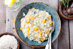 Pumpkin, blue cheese risotto in a ceramic plate Stock Photography