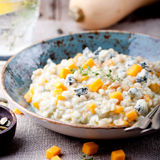 Pumpkin, blue cheese risotto in a ceramic plate Stock Photo