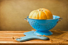 Pumpkin in blue colander Stock Image