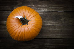 Pumpkin on Board Stock Image