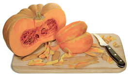 Pumpkin board knife. Pumpkin, cut into pieces, cleaned with a metal knife and wooden board, isolated on white background Royalty Free Stock Images