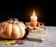 Pumpkin and books Royalty Free Stock Image