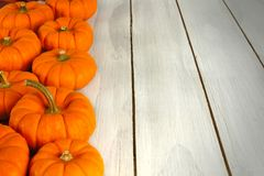 Pumpkin border on wood Stock Images