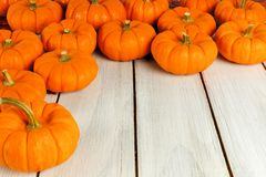 Pumpkin border on wood Royalty Free Stock Photos