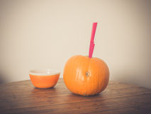 Pumpkin with bowl and knife Stock Photo