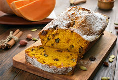Pumpkin bread and ingredients. On wooden table Stock Images