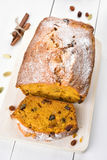 Pumpkin bread loaf. With nuts, raisin and cinnamon, focus on slice of bread Royalty Free Stock Photos